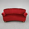 A first half of the 20th century sofa with velvet upholstery.