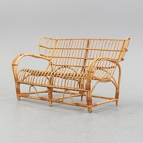 Viggo boesen, probably, a rattan sofa. second half of the 20th century.