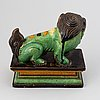 A green and yellow glazed buddhist lion, qing dynasty, 19th century.