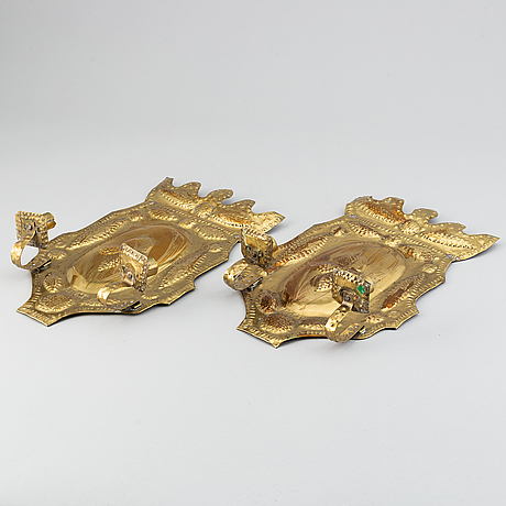 A pair of early 20th century, brass wall scones.