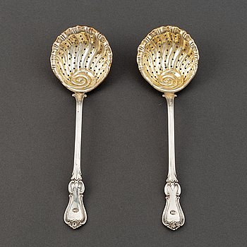 A pair of Swedish 19th century parcel-gilt silver caster-spoons, mark of PF Palmgren, Stockholm 1864.
