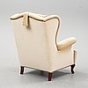 A mid 20th century wing chair.