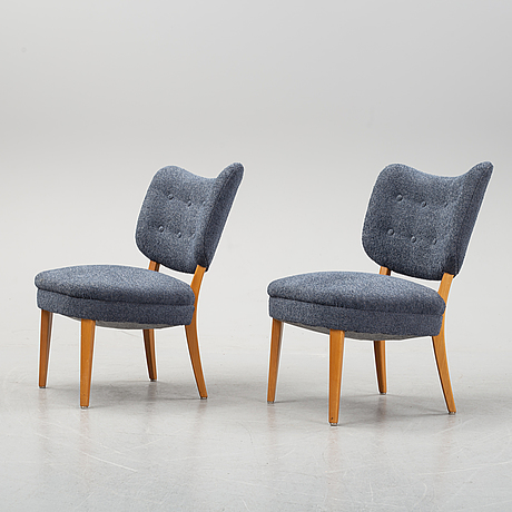 A pair of swedish modern easy chairs, mid 20th century.