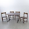 A set of four chairs and a table gemla diö later part of the 20th century.