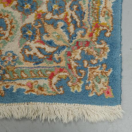 A carpet, a semi-antique/an old kerman, ca 270,5-272,5 x 182-183 cm.