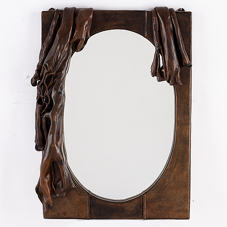 A mirror with a frame of sculpted leather, designer unknown, 20th century.