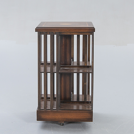 An english walnut book shelf alter part of the 20th century.