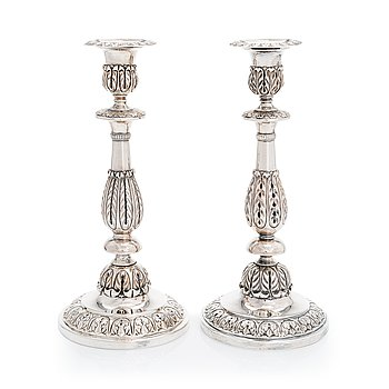 A pair of Russian silver candlesticks, maker's mark of Carl Johan Heyne, Saint Petersburg 1825.