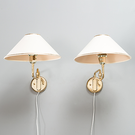 A pair of late 20th century wall lights for raf.