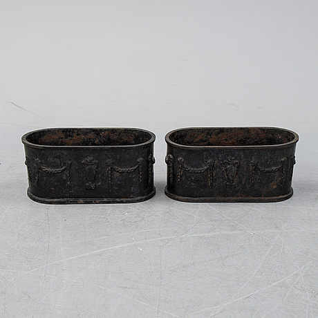 A pair of 20th century cast iron plant pots.