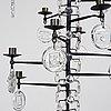 Erik höglund, a wrought iron and glass chandelier, boda smide, sweden.