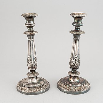 A pair of 19th century white metal candlesticks, unmarked.