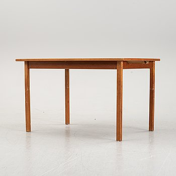 A 1950's teak dining table.