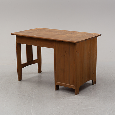 A stained pine writing desk attributed to carl westman, early 20th century.