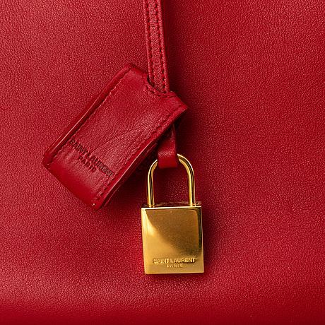 Saint laurent, a red leather 'sac du jour small' bag.