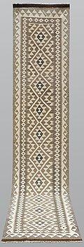 A runner, an Oriental kilim, ca ca 392 x 79 cm.