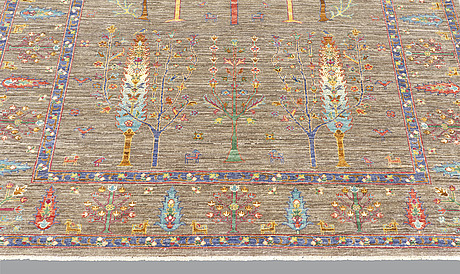 A rug, ziegler design figural, ca 241 x 169 cm.