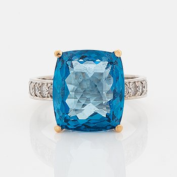 Cushion shaped blue topaz and diamond cocktail ring.