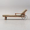 A second half of the 20th century stained pine sunbed by elsa stackelberg, fri form.