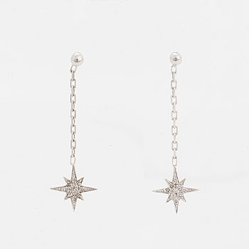 Small eight-cut diamond star earrings.