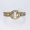 Ring 18k gold navette, brilliant and baguette-cut diamonds approx 1,5 ct in total.