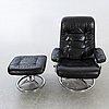 A leather swivel armchair and stool, söderbergs  1980s.