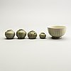A group of olive green glazed vessels, south east asia, presumably thailand.