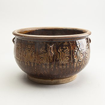 A large brown glazed jar, South East Asia, presumably 19th Century.