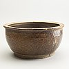 A large brown glazed flower pot, possibly south china, guangdong ware, ming dynasty (1368-1644).