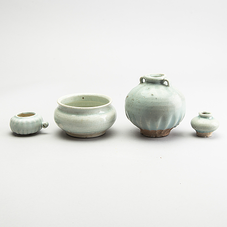 A group of four pale green glazed vessels, south east asia, presumaby sukothai, 14th/16th century.
