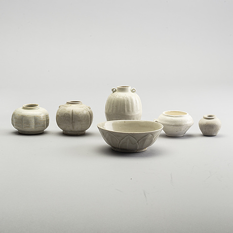 A group of white glazed south east asian vases and bowls, partly 16/17th century.