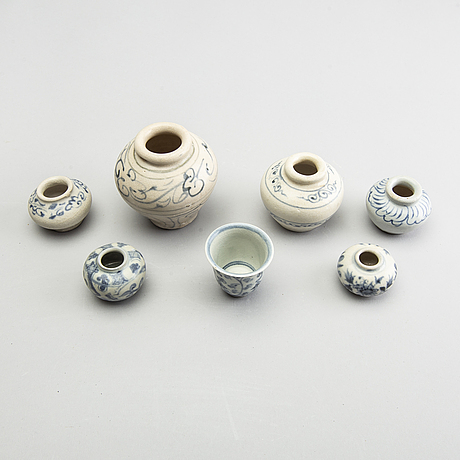 A group of six blue and white south east asian jars and a cup, 17th/18th century.