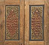 A pair of south east asian carved wooden doors, presumably java, 19th century.