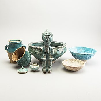 A group of turkoise glazed Persian objects.
