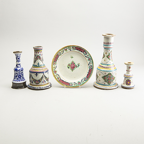A set of four persian ceramic water pipe bottles and a dish, early 20th century. chinoiserie.