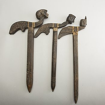 Three Javanese wooden planting sticks, presumably early 20th Century.