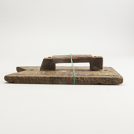 A set of 3 persian carpet weavers combs and a wood printing block, 20th century.