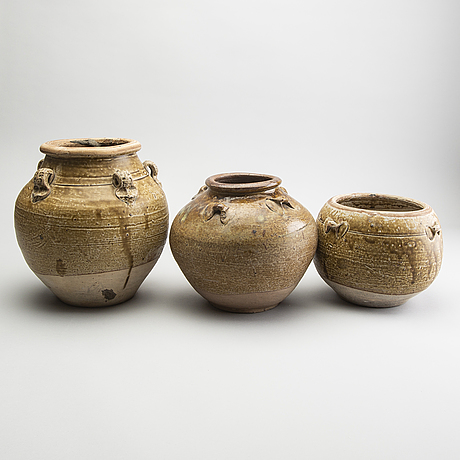 A group of three olive glazed jars, south east asia, presumably 16th/18th century.