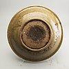 A celadon ge glazed dish, south east asia, presumably sawankhalok, 15th/17th centuyr.