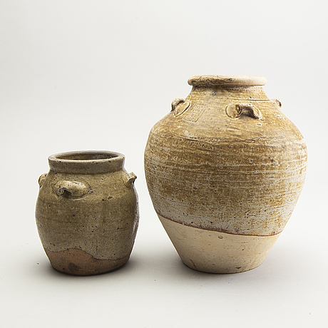 Two olive green glazed south east asian jars, 14th/17th century.