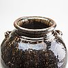 A south east asian brown and black glazed jar, 14th/17th century.