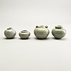 A group of four celadon glazed miniture pots, south east asia, 16th/17th century.