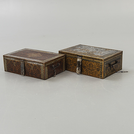 Two perisan metal safety boxes, early 20th century, one of them with a russian inkription and dating to 1928.