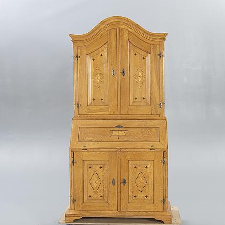 A swedish oak desk cabinet around 1800.