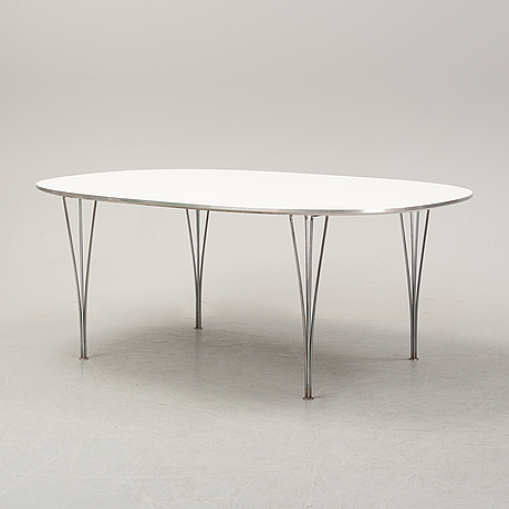 A 'superelliptical' dining table by bruno mathsson & piet hein for fritz hansen, dated 1990.