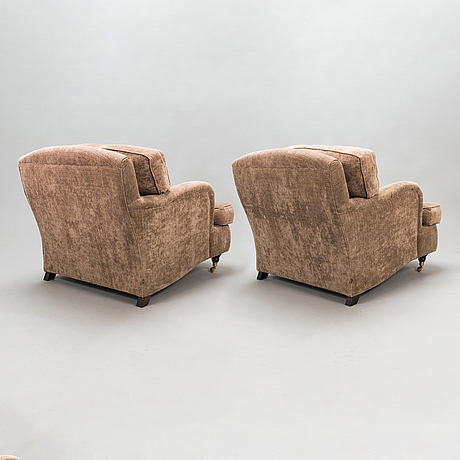 A pair of 21st century 'howard' style armchairs.