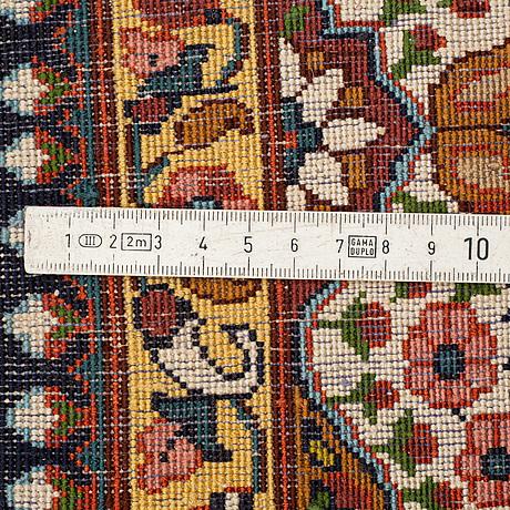 A rug, kashmir probably, ca 216 x 123,5-128,5 cm.