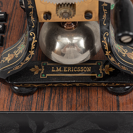 """A 1990s table telephone """"taxen"""" by lm ericsson."""