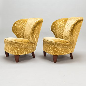 A pair of mid 20th century armchairs.