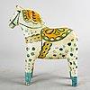 "An early 20th century wooden horse, ""dalahäst""."
